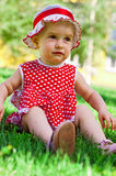 Happy little girl on a lawn Royalty Free Stock Photos