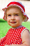 Happy little girl on a lawn Stock Photography