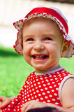 Happy little girl on a lawn Stock Image