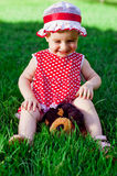 Happy little girl on a lawn Stock Photo