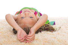 Happy little girl lays on her back Royalty Free Stock Photo