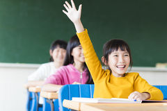 Happy little girl learning in the classroom Stock Photos