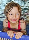 Happy little girl learning to swim Royalty Free Stock Photo