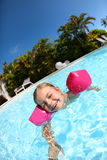 Happy little girl learning to swim Royalty Free Stock Image