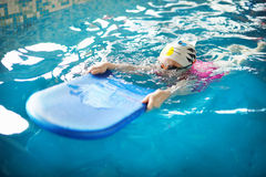 Happy little girl learning to swim Royalty Free Stock Photos