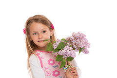 Happy little girl with lilac flowers Stock Photos