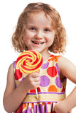 Happy little girl with a lollipop Royalty Free Stock Photo