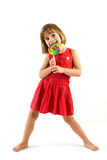 Happy little girl a lollipop Stock Photo