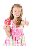 Happy little girl with lollipop and figer up. Isolated on a white royalty free stock photo