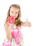 Happy little girl with lollipop isolated Stock Images