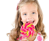 Happy little girl with lollipop isolated Stock Photo