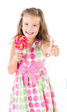Happy little girl with lollipop isolated Royalty Free Stock Photos