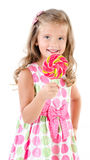 Happy little girl with lollipop isolated on a white Stock Photos