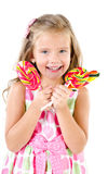 Happy little girl with lollipops isolated Royalty Free Stock Image