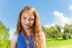 Happy little girl with long curly hairs outside Royalty Free Stock Images