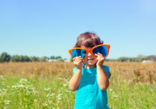 Little girl with a big sunglasses Royalty Free Stock Photos