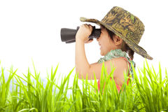 Happy little girl looking through binoculars outdoors. Education concept Royalty Free Stock Images