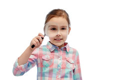 Happy little girl looking through magnifying glass Stock Images