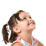 Happy little girl looking up. Smiling little child looking up at copyspace isolated on white background Stock Image
