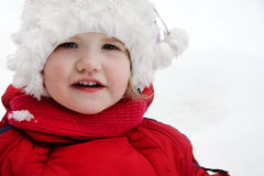Happy little girl looks at camera Royalty Free Stock Images