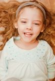 Happy little girl lying on floor. This image has attached release Stock Photos