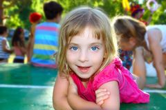 Happy little girl lying on table tennis park Stock Photography