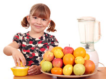Happy little girl make juice Stock Photos