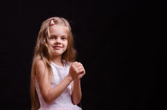Happy little girl make a wish Royalty Free Stock Image