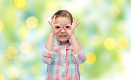 Happy little girl making faces and having fun Royalty Free Stock Image