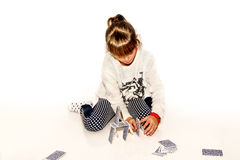 Happy little girl making house of cards isolated on white Stock Photography
