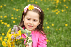Happy little girl in the meadow Royalty Free Stock Images