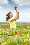 Happy little girl on meadow Stock Photos