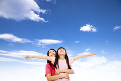 Happy little girl and mother watching the sky Stock Photo