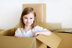 Happy little girl moving in her new home Stock Photo