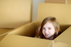Happy little girl moving in her new home Royalty Free Stock Images