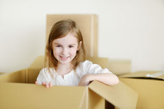 Happy little girl moving in her new home Royalty Free Stock Photos