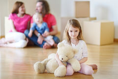 Happy little girl moving in her new home Stock Image