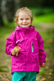 Happy little girl with a mushroom Royalty Free Stock Image