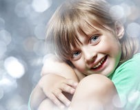 Happy Little Girl On Light Royalty Free Stock Images