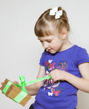Happy little girl opening gift box Royalty Free Stock Images
