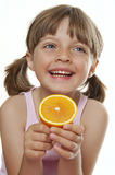 Happy little girl with an orange Royalty Free Stock Photo