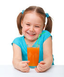 Happy little girl with orange juice Stock Image