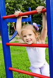 Happy little girl on outdoor playground equipment Royalty Free Stock Photos
