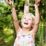 Happy Little girl outdoors Royalty Free Stock Images