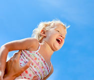Happy little girl outdoors Royalty Free Stock Photos