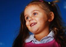 Happy little girl outside Stock Image