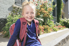 Happy little girl outside with backpack Royalty Free Stock Photo