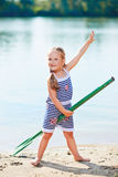 Happy little girl with paddle at beach Stock Photography