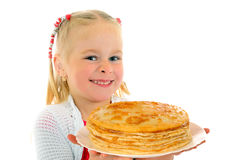 Happy little girl with pancakes Royalty Free Stock Images