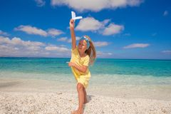 Happy little girl with paper airplane during beach Stock Photography